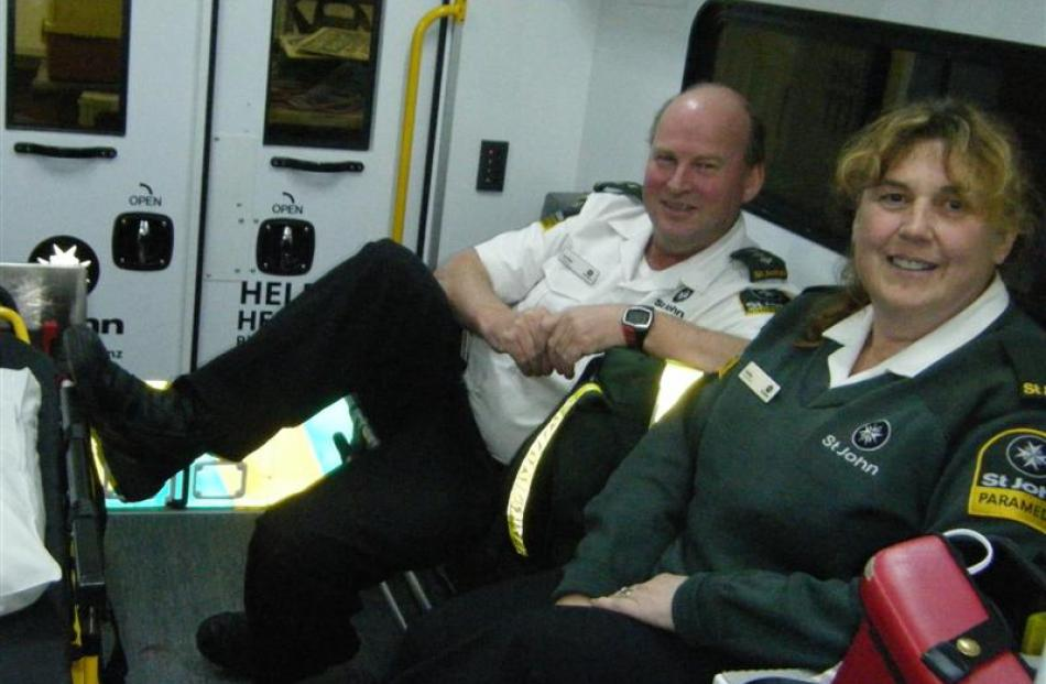Ambulance officers Pat Bain and Debby Foster sit in the ambulance.