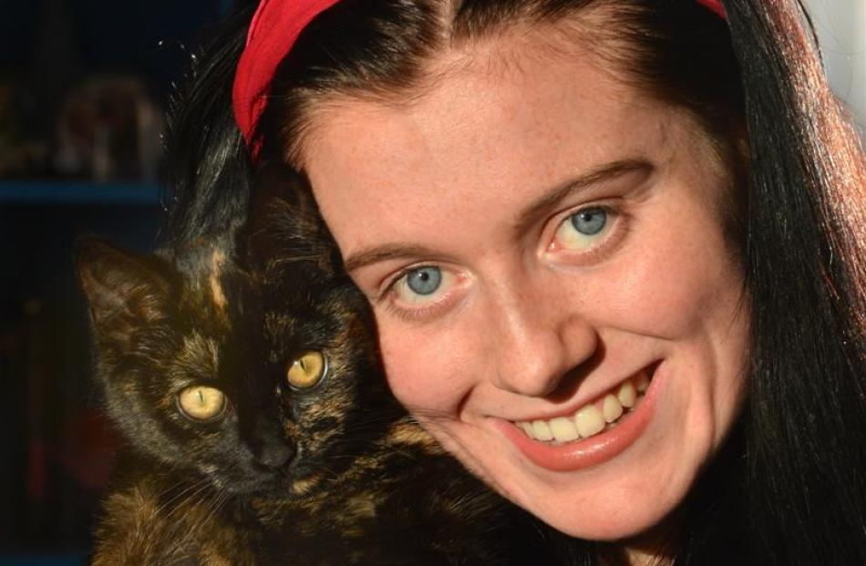 Nikita Rosenbrock (17), of Concord, with Cat.
