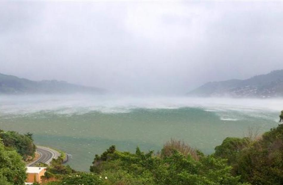 A southerly front charges up Otago Harbour towards Macandrew Bay at 3.09pm on Saturday. Photo by...