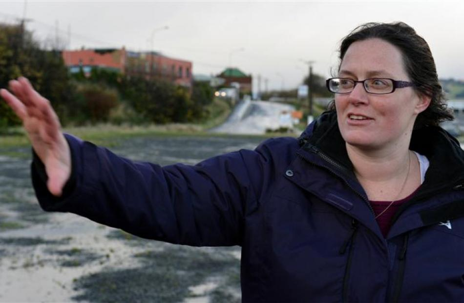 Bernadette White, of Dunedin explains how a container she was helping unpack toppled over in the...