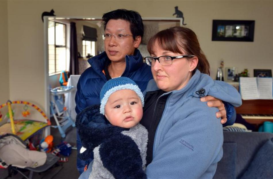 Matthew and Angela Young, with their son, Oliver (5 months),wrap up  in their Outram home after a...
