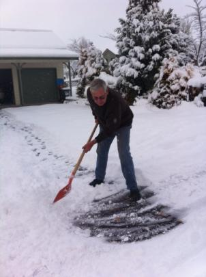 Ray Prouting, of Arrowtown, clears his driveway. Photo by Tracey Roxburgh
