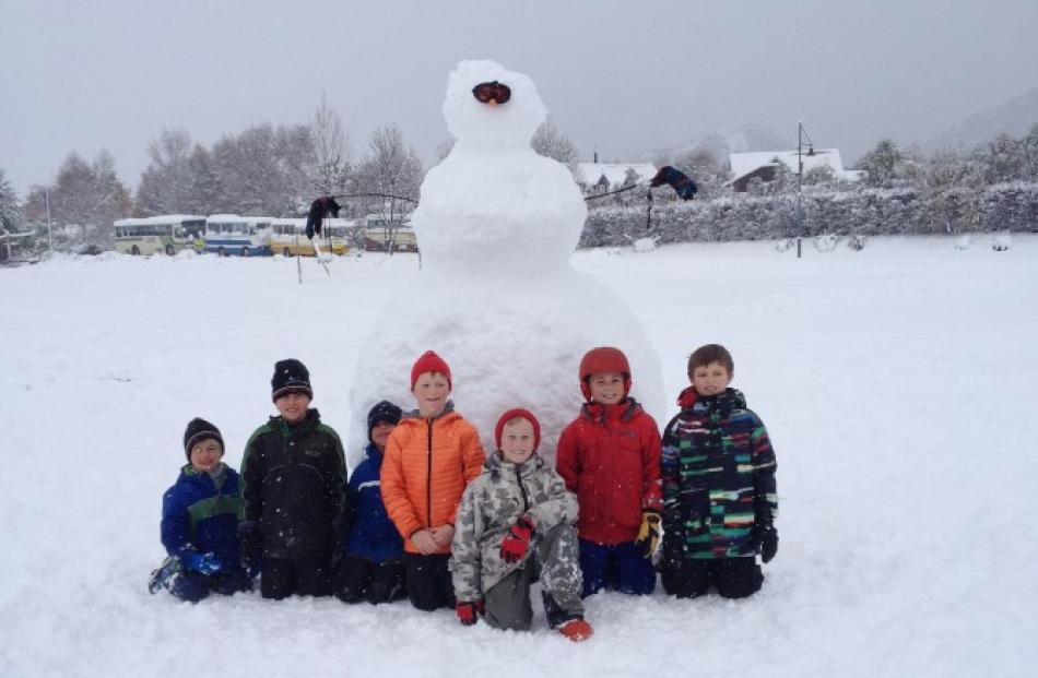 At Arrowtown Primary School, closed today, are (l-r): Willi Stanley (5), Charlie Stanley (9),...