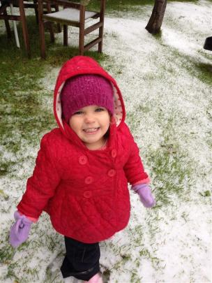 My 2 year old Isobel thrilled to be in the snow! Photo by Anne Scott