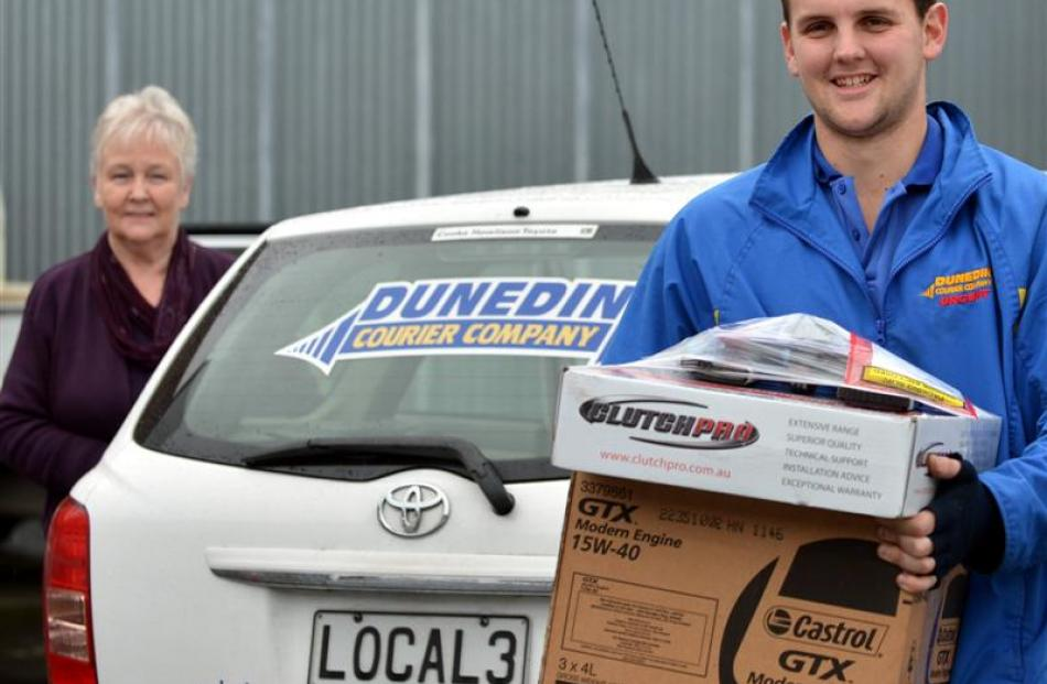 Dunedin Courier Company office manager Di Cochrane with courier Sam Stevenson (23).