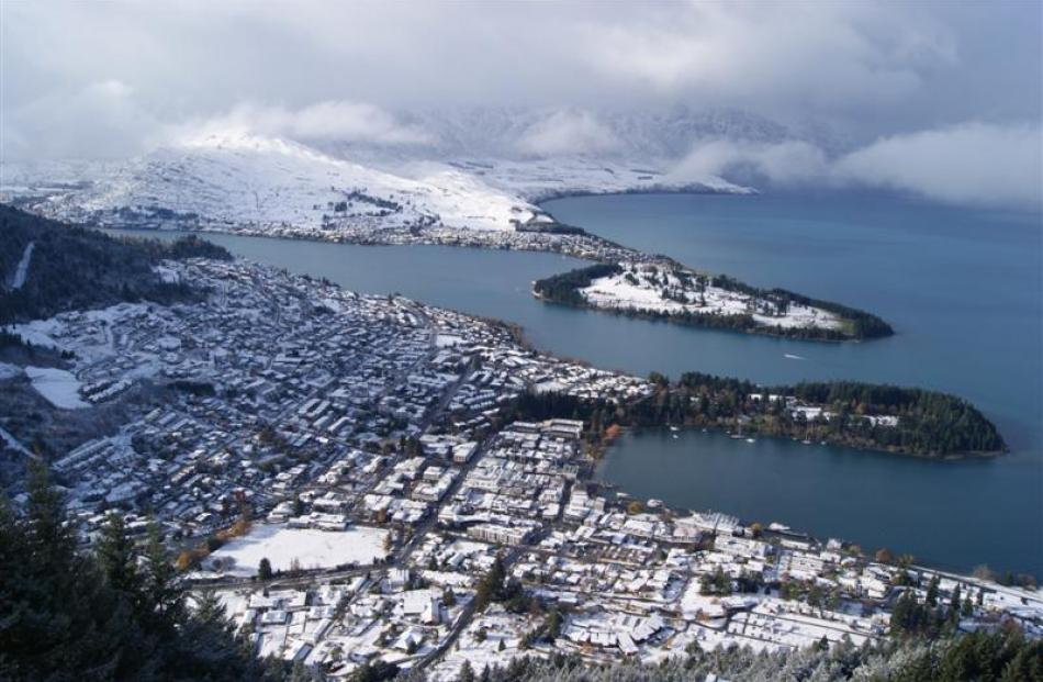 A snow-covered Queenstown from the Skyline.