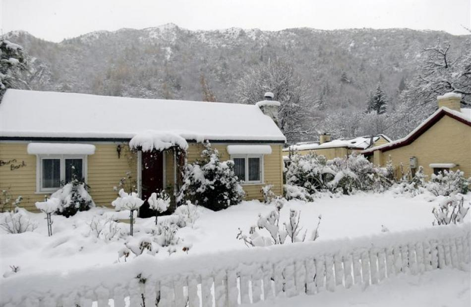Arrowtown residents woke to 20cm of snow yesterday. This cottage is on Centennial Ave, near...