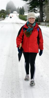 Bank officer Kaye Bretherton walks down Taieri Rd yesterday.