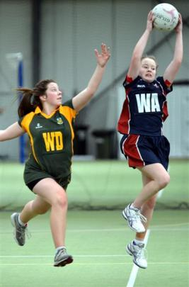 Hayley Jenkinson (left, East Otago)  and Abbey Constable (Kavanagh College) in netball action at...