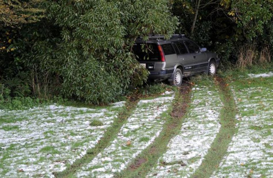 A car that slid off Eglinton Rd, Mornington, yesterday. Photos by Craig Baxter.