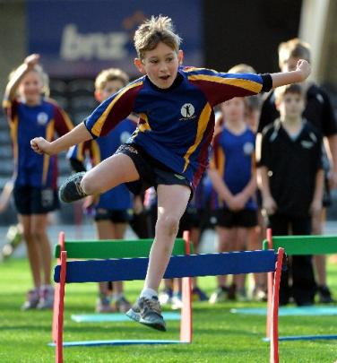 Ben Nicol (10), of Outram School, jumps over a hurdle.
