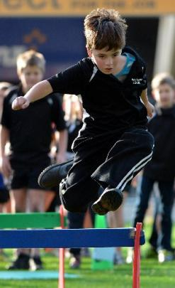 Greg Jones (9), of Waikouaiti School, is focused as he leaps.