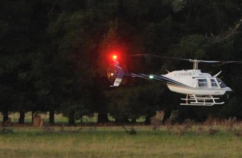 A helicopter is used to search for  escaped prisoner Stephen Uriah Maddren on a Milburn farm ...