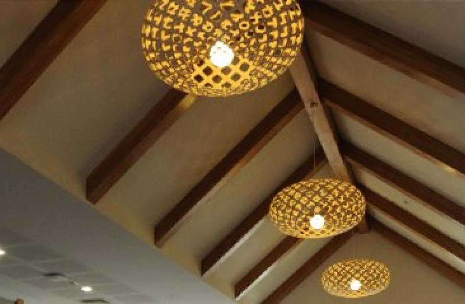 The bilingual centre has a pitched ceiling reminiscent of a meeting house.