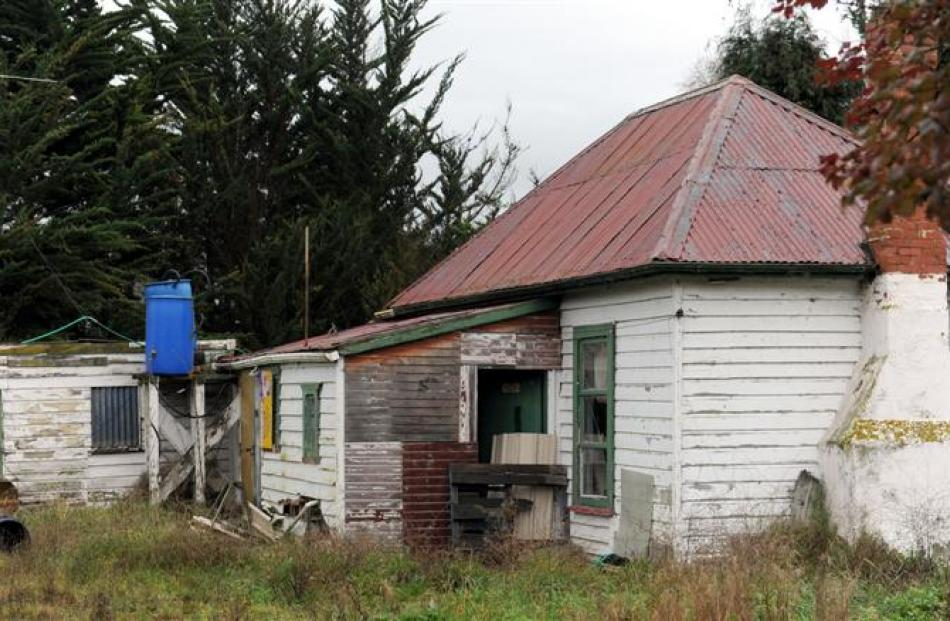 An empty house in Narrowdale Rd, near Otago Corrections Facility, which has had its front door...