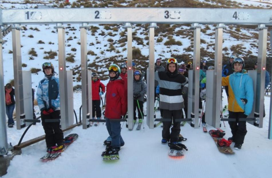 First on the chairlift for the 2014 season were (from left) Cooper Neilson, Jacob O'Donoghue...