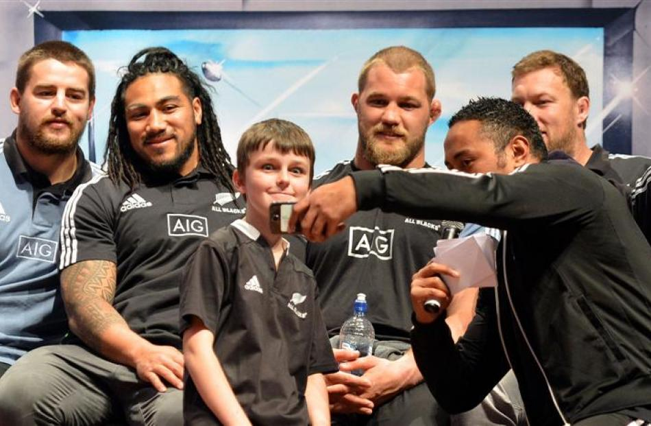 Small Blacks TV host Nua Finau takes a photo of Matthew Tebbutt (10), of Dunedin, on the stage...