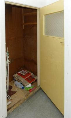 The cupboard in the shearers residence where he hid.