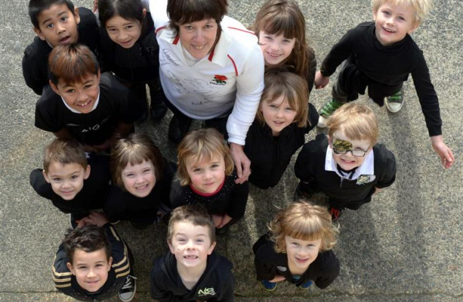 Arthur Street School teacher Sandra Darracott, of Bletchley, England, is outnumbered by pupils ...