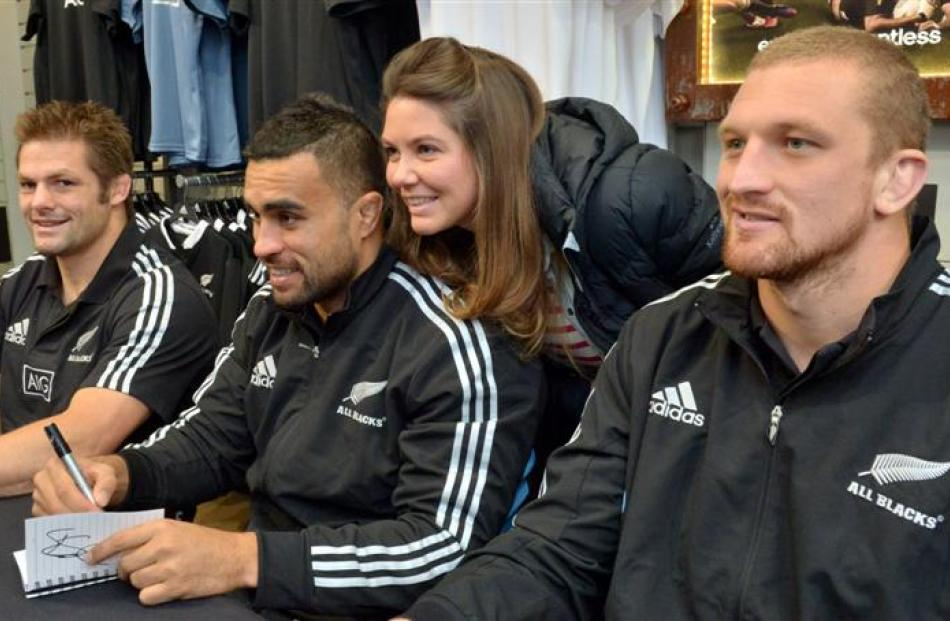 French fan Sarah Prabonnaud (26), of Brittany, photo bombs All Blacks (from left) Richie McCaw,...