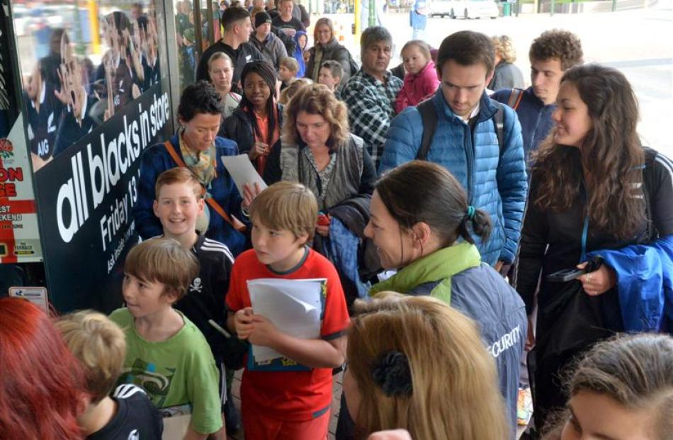 Rugby fans line up outside Champions of the World yesterday,  for an autograph-signing session...