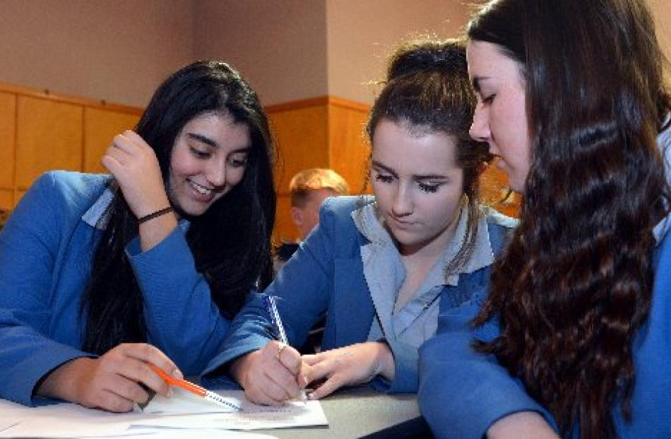 Jaya Verma (14), Caitlin McKinlay (14) and Zoe O'Leary (15), of Queens High School 2, have a spell.