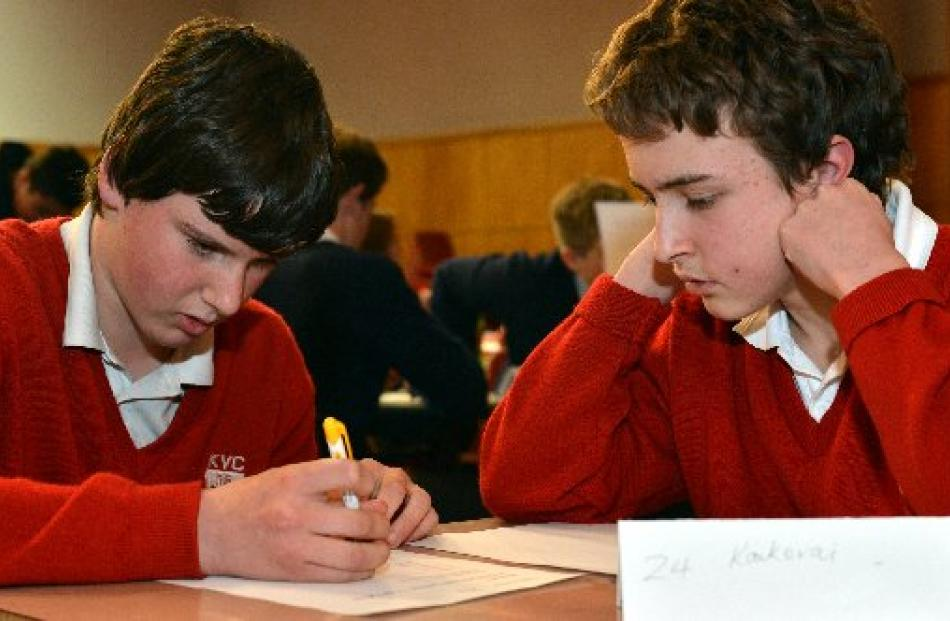 Troy Martin (12) and Alex Wilson (13), of Kaikorai Valley College 5, confer.