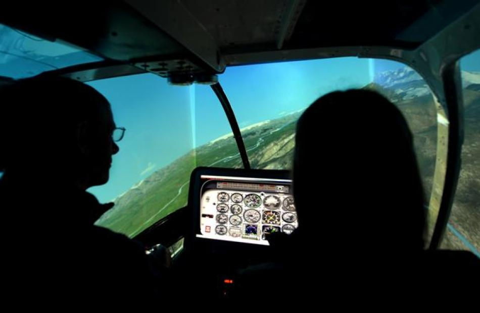 Graeme Gale takes Jade for a trial in a simulator before her real-life flight.