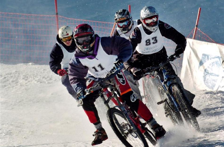 2004: James Dudd of Hamilton leads a heat of the Mountain Bikes on Snow event at Coronet Peak. ...