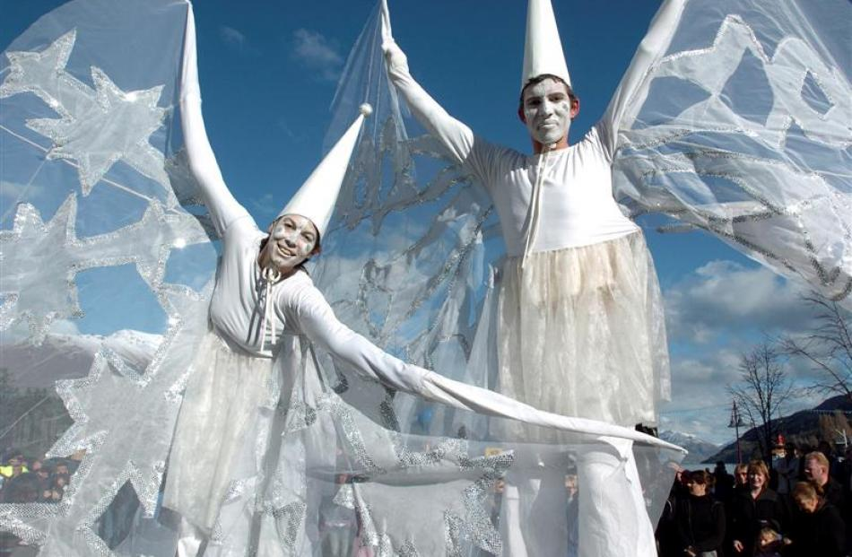 2004: Stilt walkers in action during the festival parade in Queenstown. Photo by Barry Harcourt.