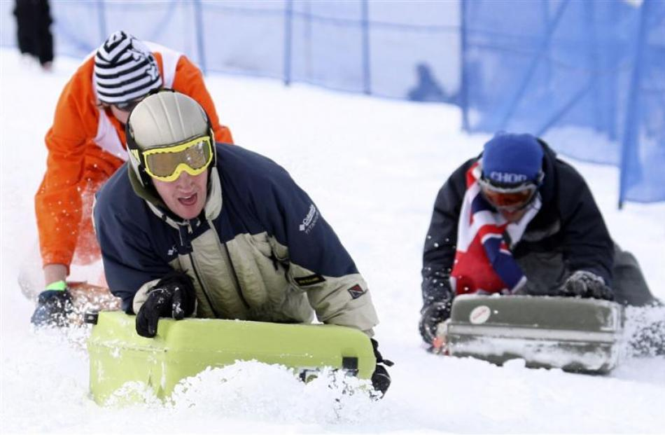 2009: George Bannerman of Gore leads his heat of the suitcase race on Coronet Peak.  Photo by...