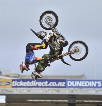 Travis Pastrana performs a backflip with passenger Bonnie McLeod at Carisbrook in February 2011.