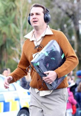 Queenstown's Joel Peasey with a ''1970s iPod'' during the Golden Mile race on Saturday. Photos by...