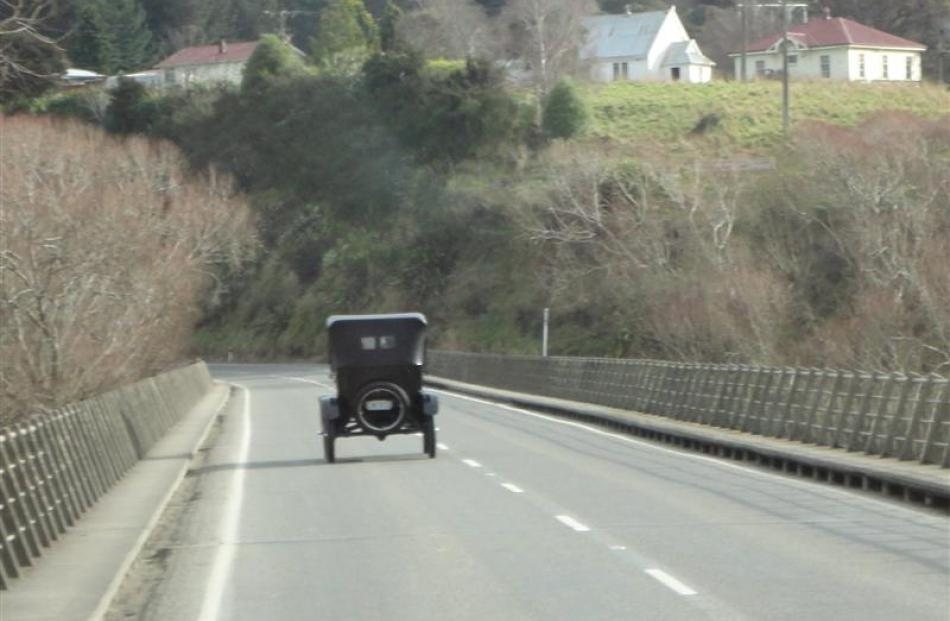 David Roff's 1927 Model T Ford crosses the Taieri River near Outram on Saturday.