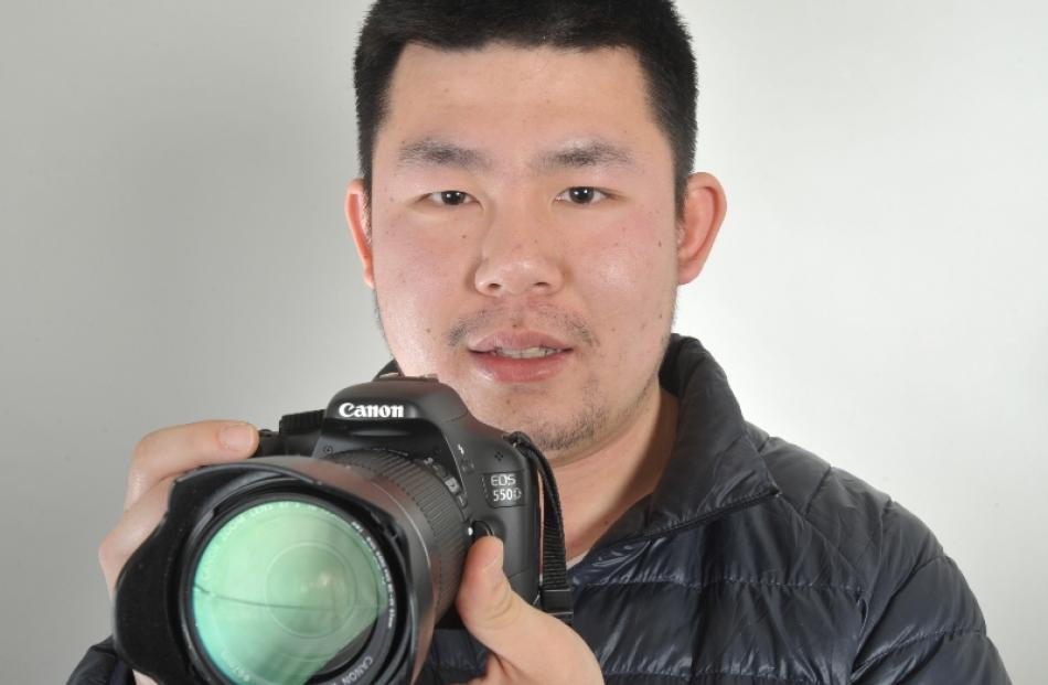 Terence  Huang (25) with the camera that captured the strange objects in the sky on Monday night....
