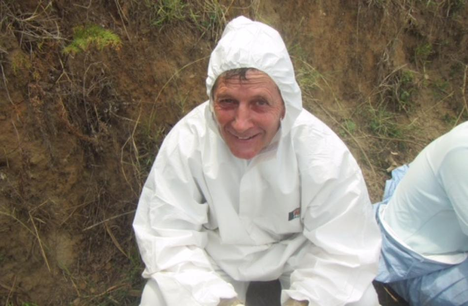 Oamaru vet Ivan Holloway said it was exhausting wearing plastic anti-contamination suits in...
