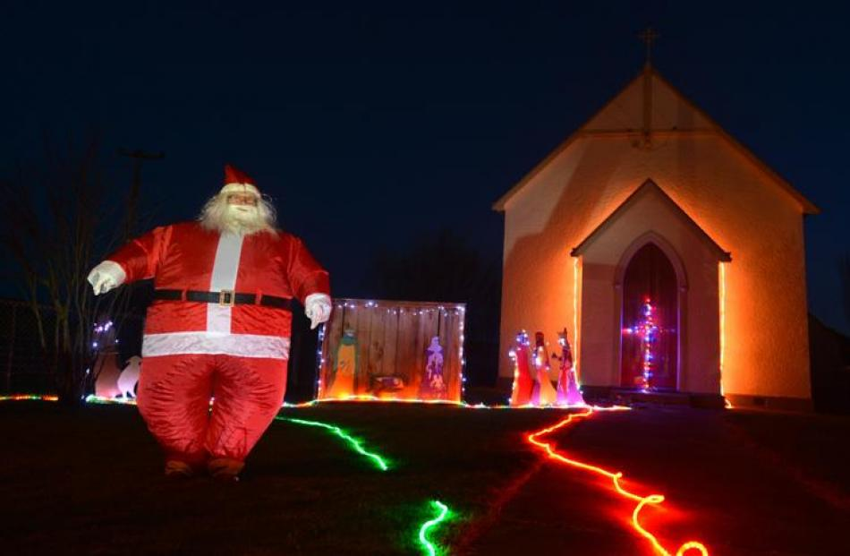 Middlemarch resident Irene Ramsay, dressed as Santa outside St Paul's Catholic Church.