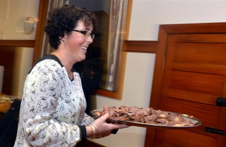 Stephanie Macaulay, of Middlemarch, delivers food to the buffet table for the Mid Winter...