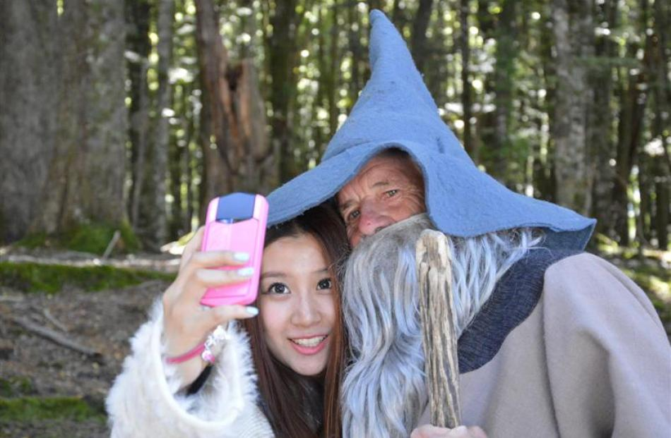 Dart River Jet guide Rod Spackman, as Gandalf, gets in a ''selfie'' with a tourist during a tour...