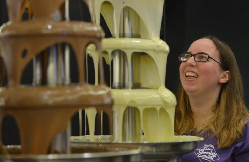 Lauren Hunter works on one of the chocolate fountains.