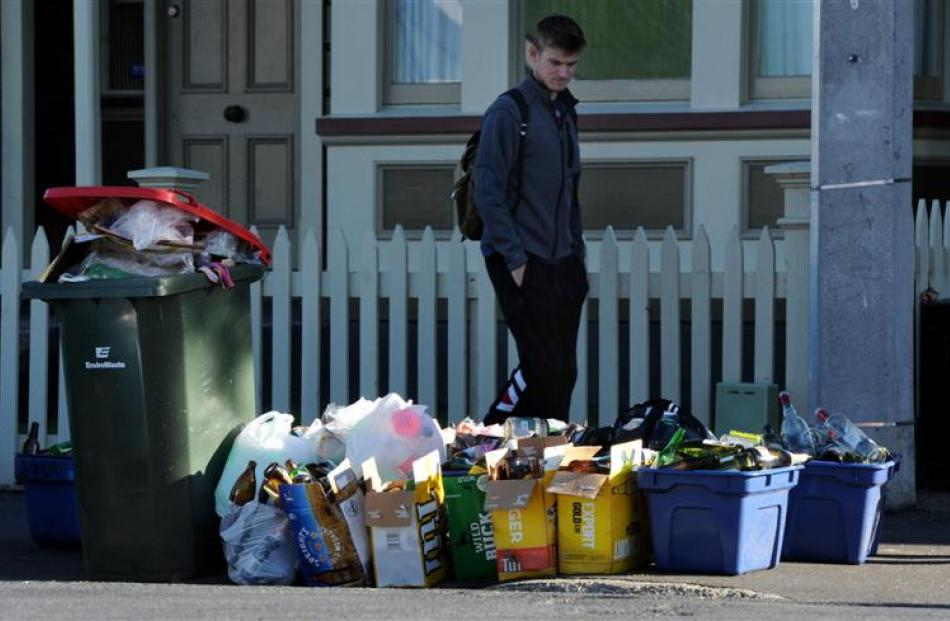 A person walks past  rubbish cleared up after weekend parties.