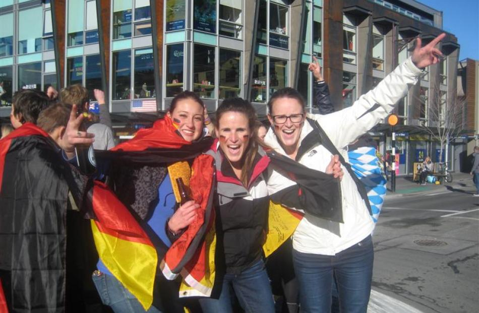 German fans (from left) Jennifer Weiss, Marie Simon and Tamara Simon, were part of a group who...