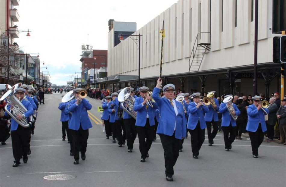 Drum major Karl Horsnell leads Mosgiel Brass during the street march.