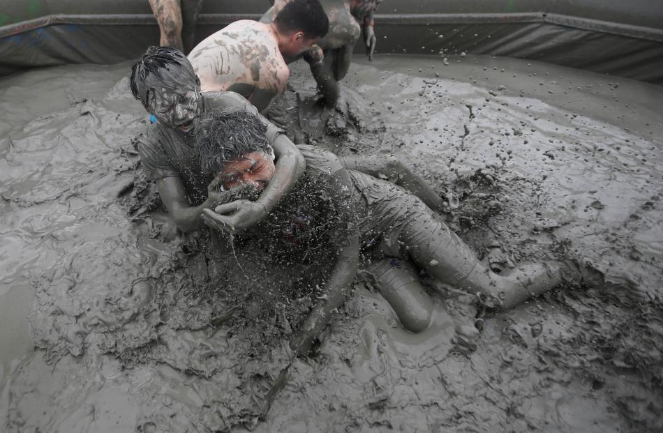 Tourists attend the Boryeong Mud Festival at Daecheon beach in Boryeong.