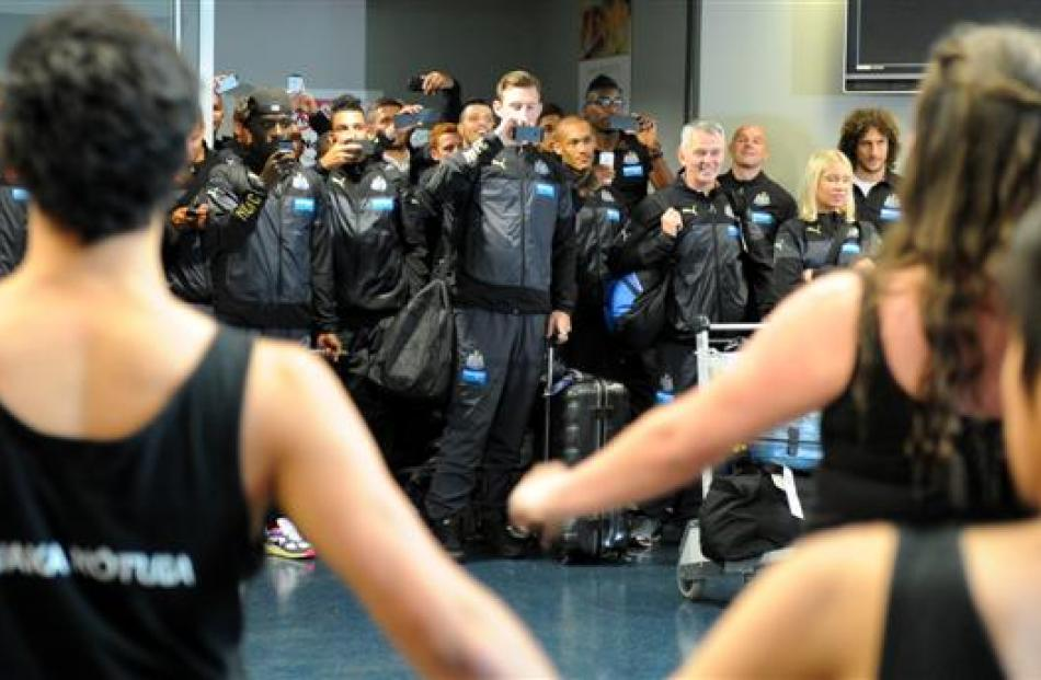 Newcastle United players film the welcome from King's and Queen's High Schools' kapa haka group...