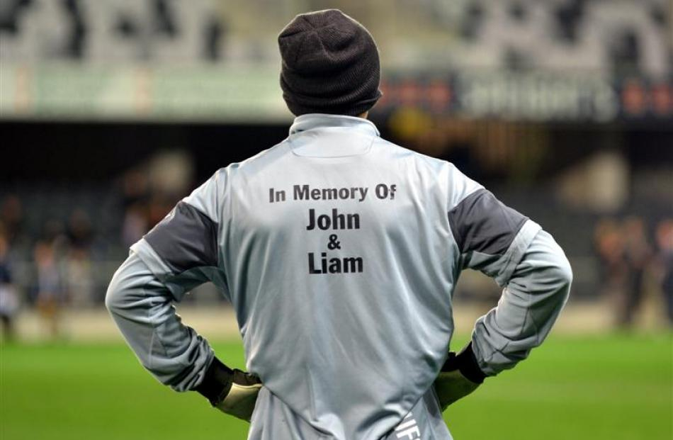 A Newcastle United player, wearing a tribute to Newcastle fans  John Alder and Liam Sweeney,...