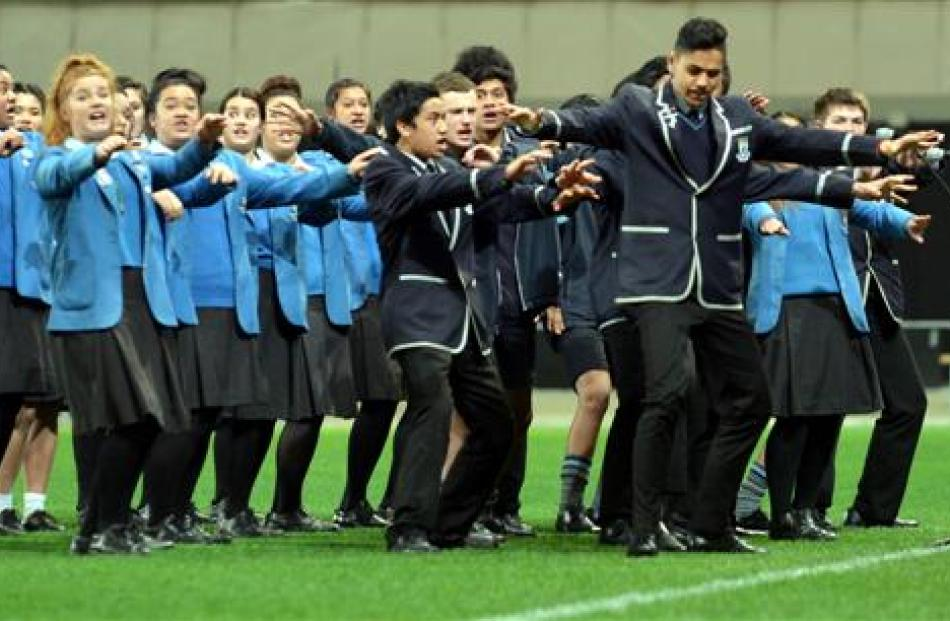 The King's and Queen's Kapa Haka group preforms.
