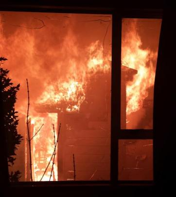 Flames engulf the rear of a Chambers St property. Photo by Joe Va'atu'itu'i.