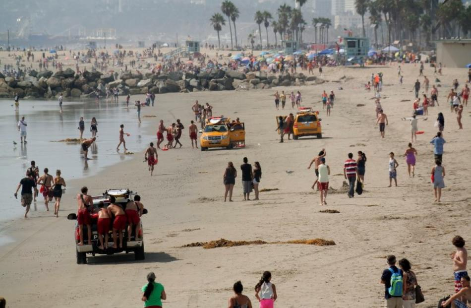 Lifeguards bring ashore one of the victims. REUTERS/Jonathan Alcorn