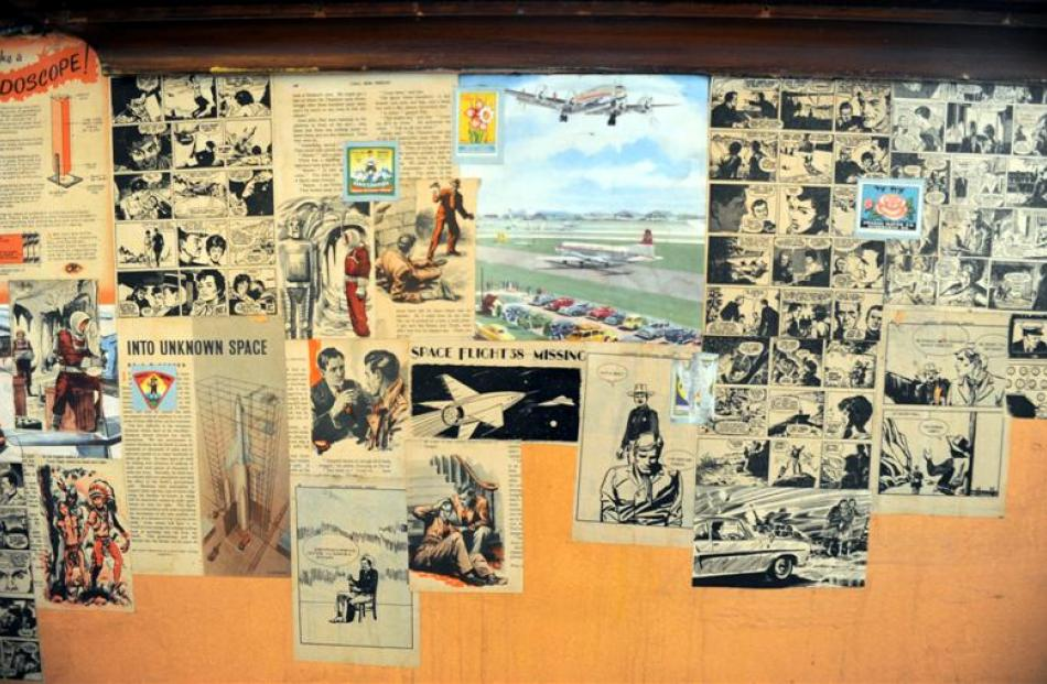 Clippings from comics belonging to a previous tenant wallpaper a room.